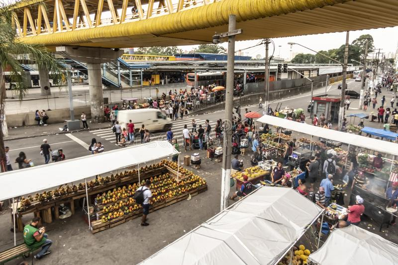 Street market next to the bus terminal of Parque Dom Pedro II, in downtown of Sao Paulo stock images