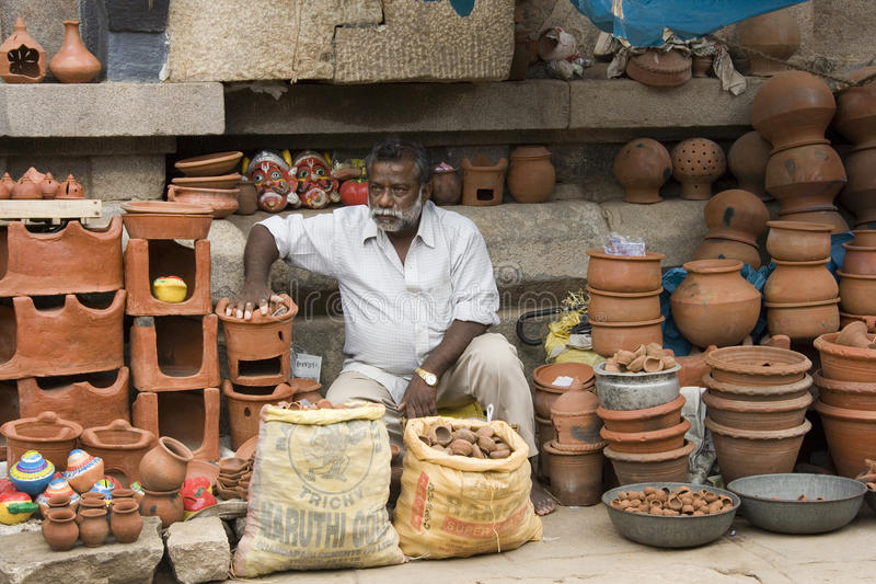Street Market - Trichy - India. Street seller on a market stall selling terracotta pots in the city of Tiruchirapalli (Trichy) in the Tamil Nadu region of royalty free stock images