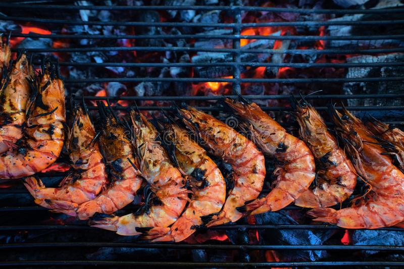 Street market with Vietnamese food and cousine. Exotic asian food. Seafood BBQ royalty free stock image