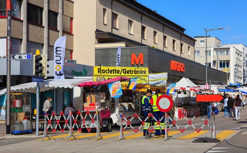 Street market in Wallisellen, Switzerland. Wallisellen, Switzerland - 13 May, 2017: people on the street market arranged in Wallisellen annually in May stock photography