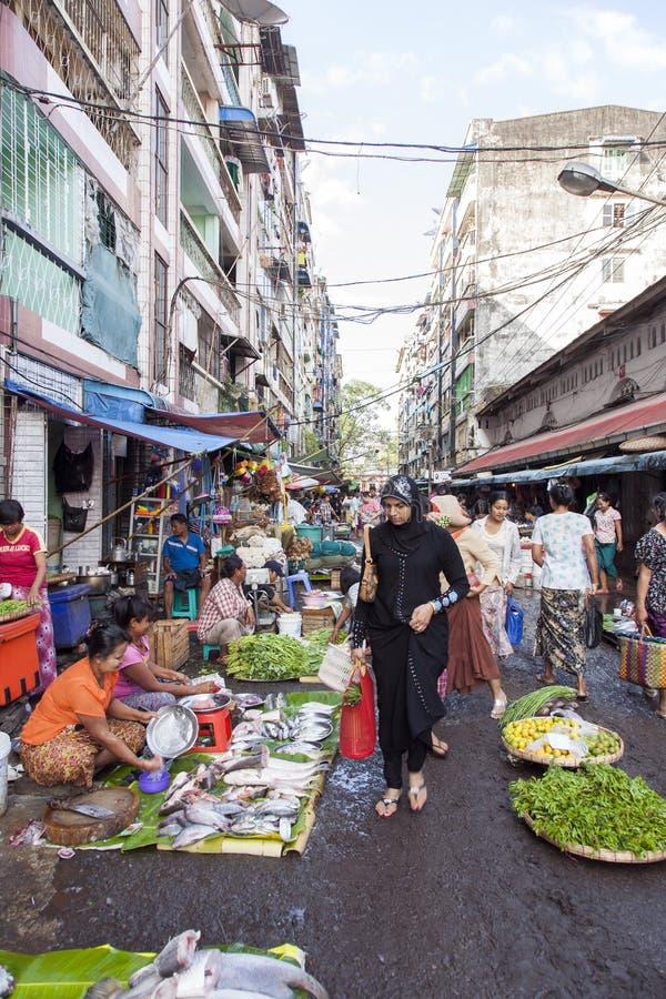 Street Market in Yangon. A vendor sells fish at a street market in downtown Yangon, Myanmar royalty free stock photo
