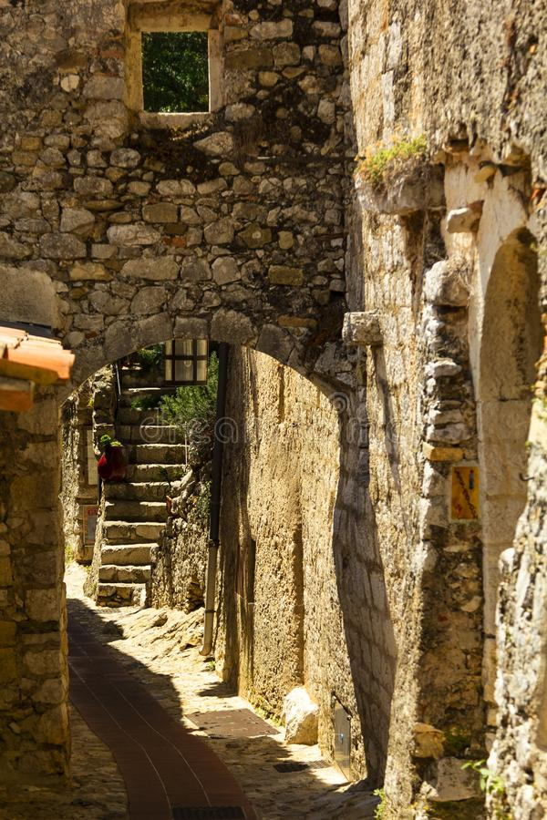 Street in medieval Eze village at french Riviera coast, Provence, France. Narrow Street in medieval Eze village at french Riviera coast near Monaco and Nice in royalty free stock photography