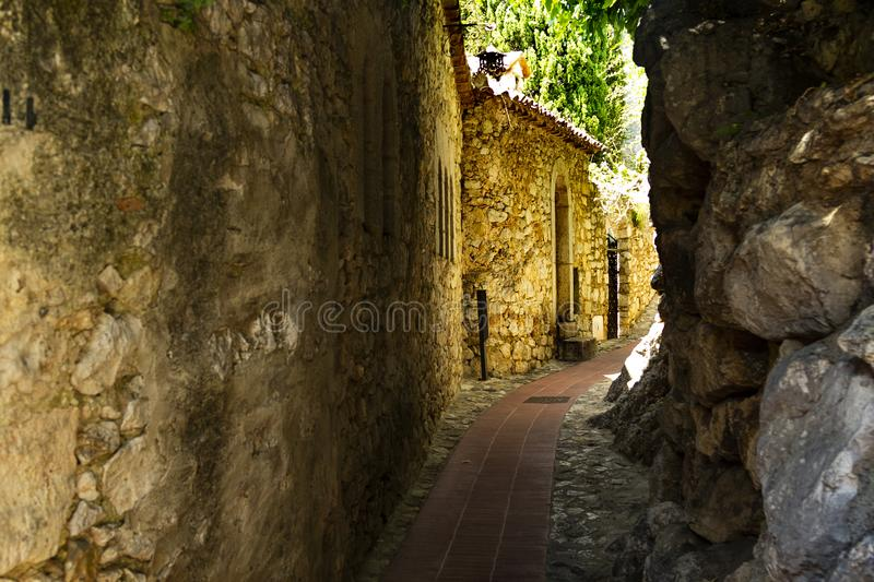 Street in medieval Eze village at french Riviera coast, Provence, France. Narrow Street in medieval Eze village at french Riviera coast near Monaco and Nice in stock photo