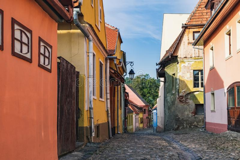 Street with medieval houses in Sighisoara, Romania stock photography
