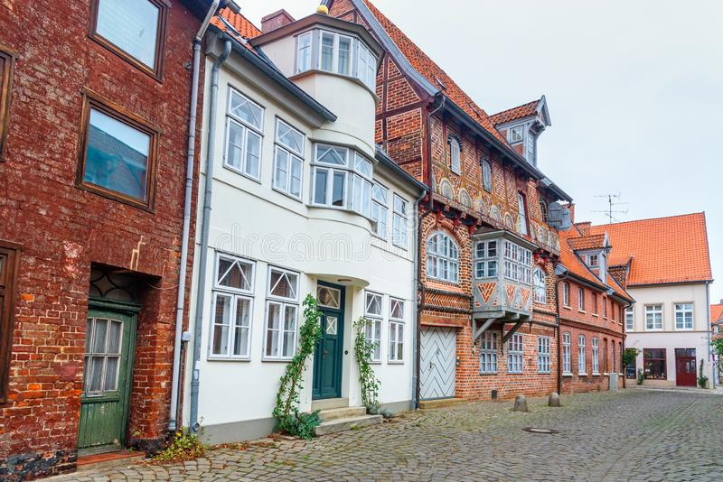 Street with Medieval old brick buildings. Luneburg. Germany stock photo
