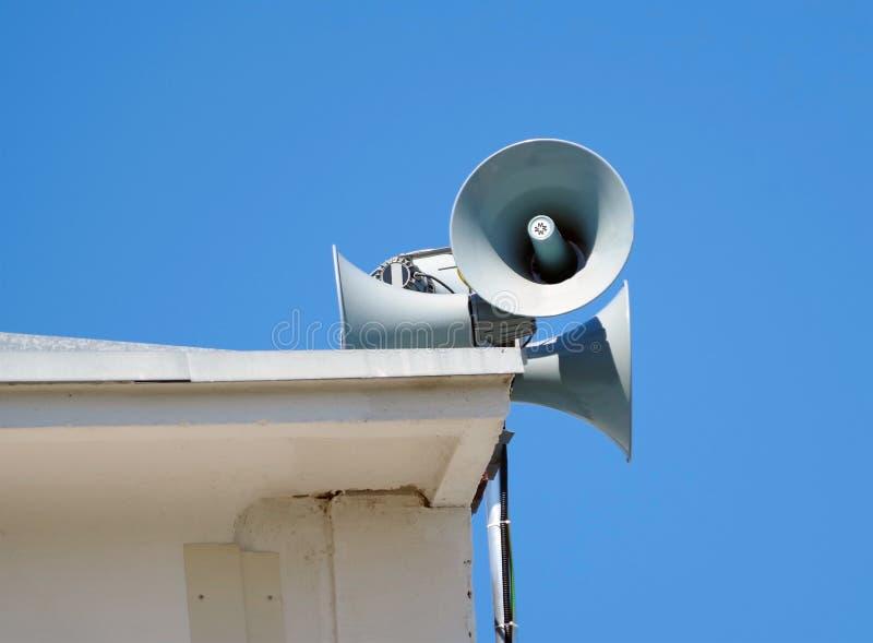 Street megaphones over the sky stock photo