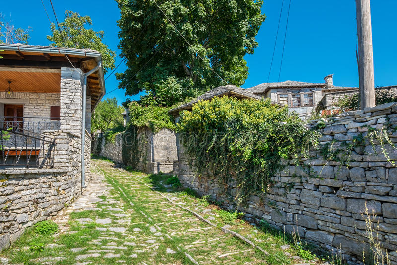 Street in Monodendri village. Zagoria, Greece. Stone walkway and houses in Monodendri, one of the stone villages of Zagoria. Epirus, Greece stock image