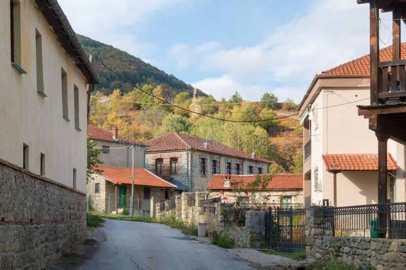 Street in the mountainous Kratero village in Florina, Greece, with old stone houses and Autumn colours. Street in the mountainous Kratero village in Florina stock images