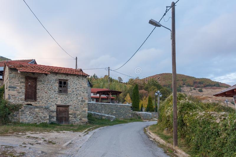 Street in the mountainous Kratero village in Florina, Greece, with old stone houses and Autumn colours. Street in the mountainous Kratero village in Florina stock photos