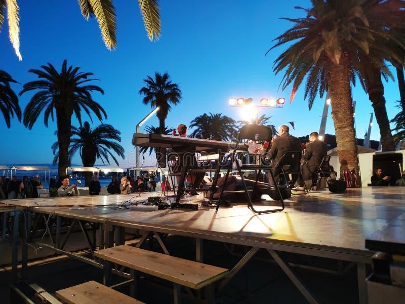 Street music show near Adriatic sea stock images