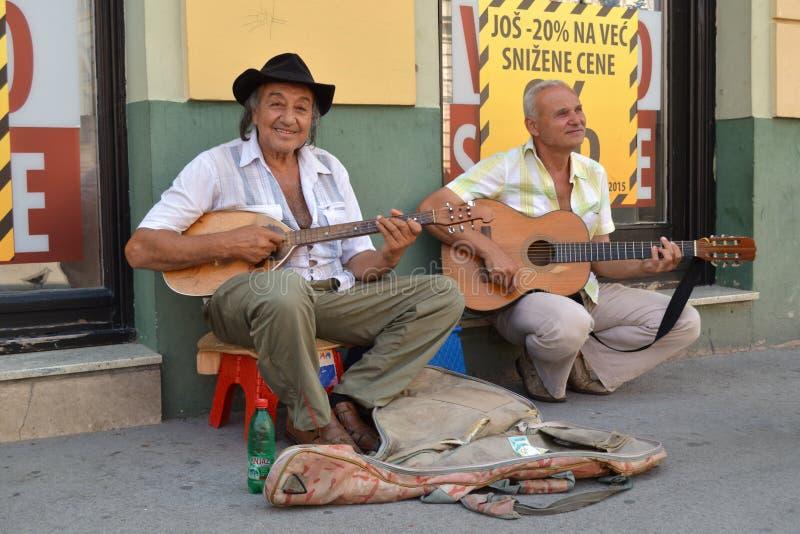 The street musician stock photos
