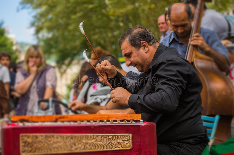 Street Musician on hammered dulcimer stock photos