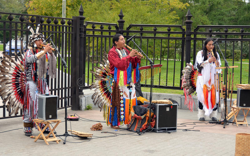 Street musician in the national Indian clothes. Music in the air - a musician in Indian clothes ndeytsev South America playing the national instrument on the stock image
