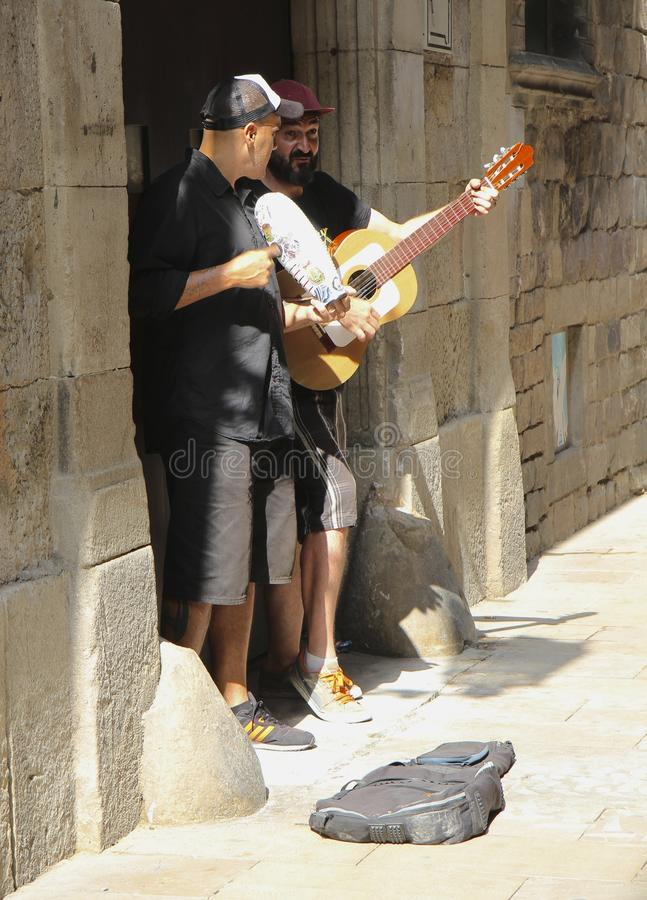 Street musician near Picasso Museum, Barcelona. royalty free stock images