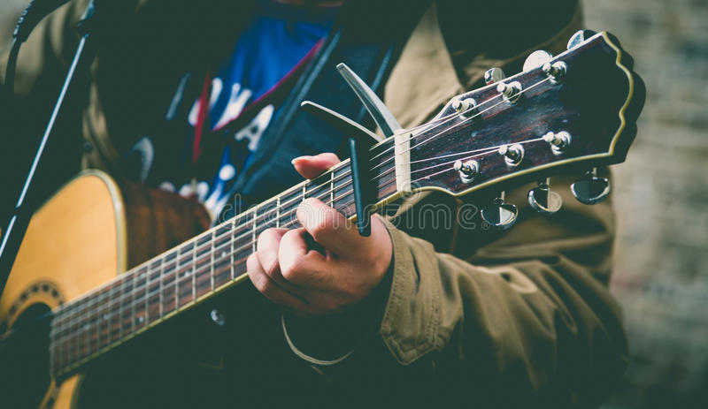 Street musician playing guitar. royalty free stock image