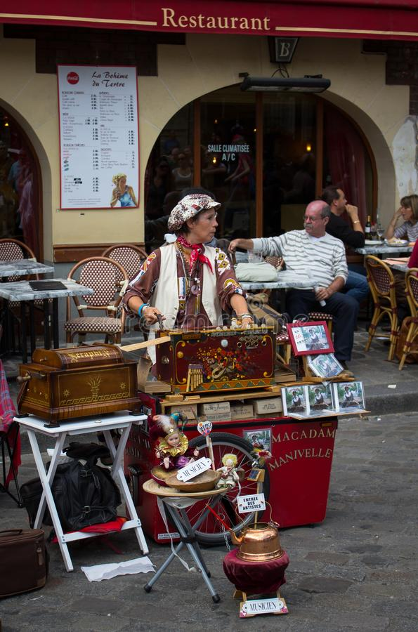 Street musician playing music instrument royalty free stock photography