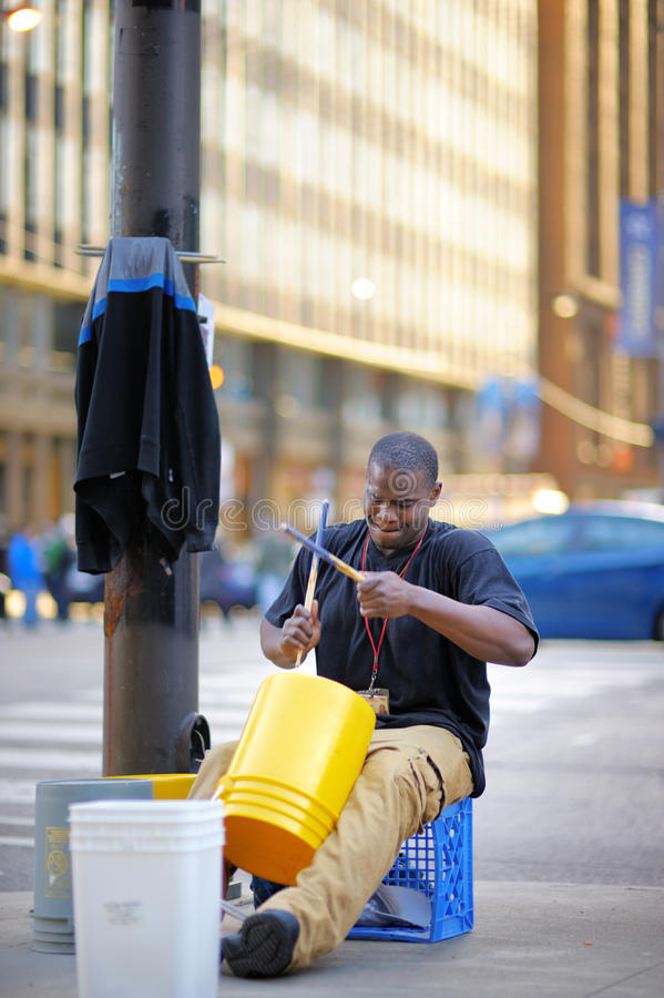 Free Street Musician Playing Rhythmical Music Using Plastic Pails On Michigan Avenue In Chicago On April 24, 2015 Stock Photos - 55998773