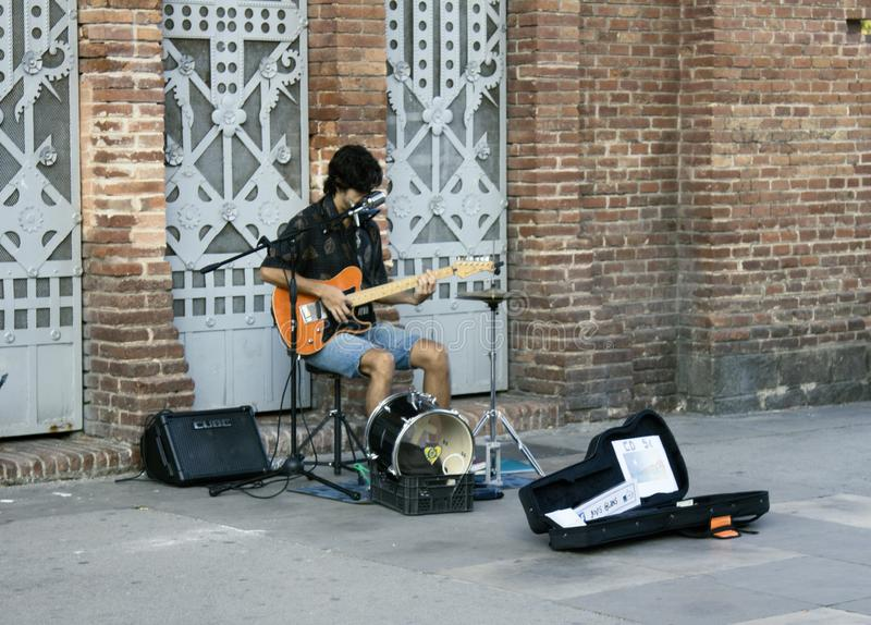 Street musician plays electric guitar, sings and collects alms royalty free stock photos