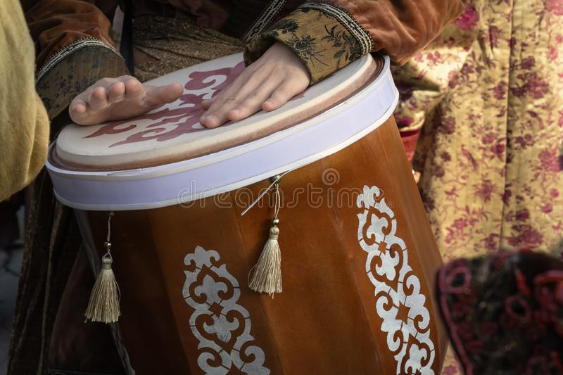 Street musician plays the traditional Asian drum. Close-up royalty free stock photos
