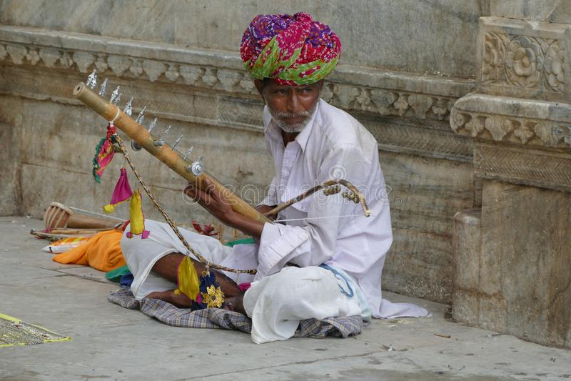 Street musician in Udaipur. Rajastan. India. In India life is on the street, where you can see all kinds of people and trades. In the city of Udaipur this man royalty free stock image