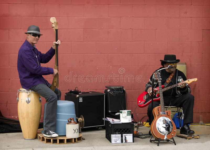 Street Musicians, Encinitas, California. Two male blues musicians, one being Tomcat Courtney whose album was up for an independent music award, play on the stock photos