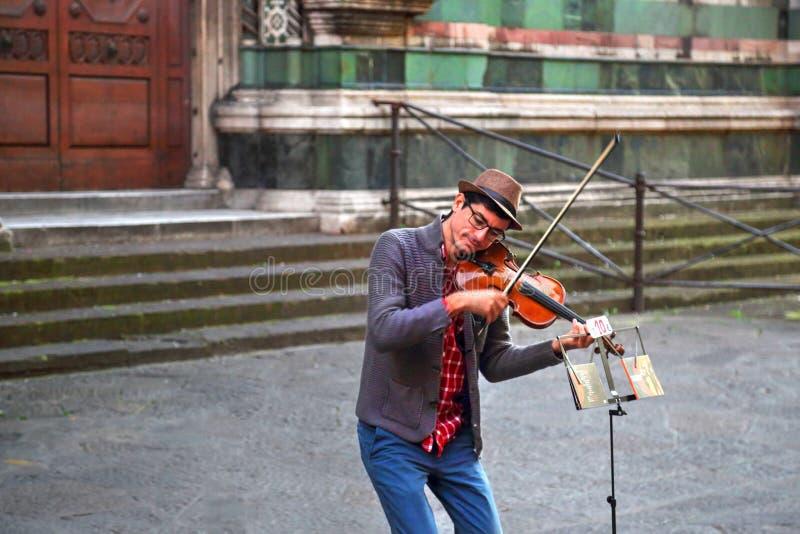 Street musicians entertaining tourists near landmark Florence attraction royalty free stock photos