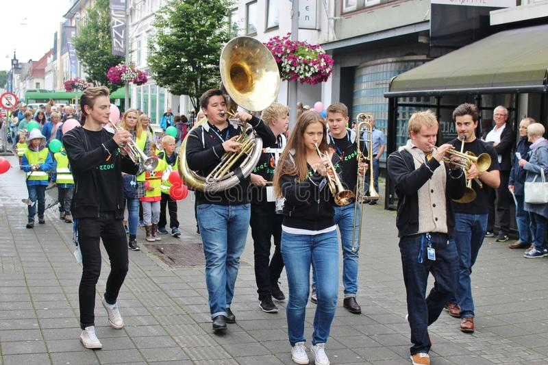 Street musicians in Haugesund, Norway, Europe. HAUGESUND, NORWAY – AUGUST 7, 2015: Swing band on the childrens parade as part of the Jazz Festival stock image