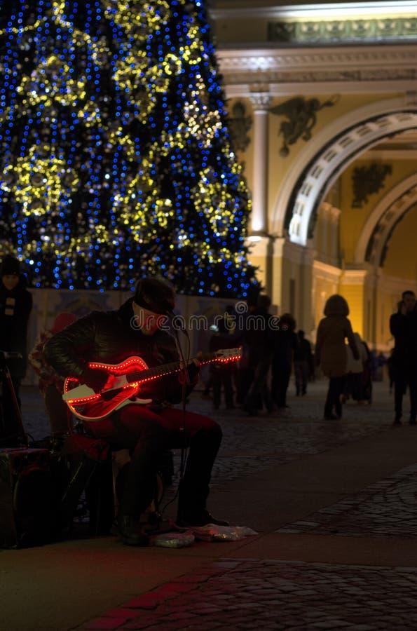 Street musicians with night illumination and Christmas tree stock photos