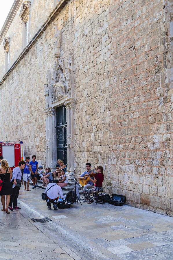 Street musicians perform on the main street of the Old City Stradun in the city of Dubrovnik, Croatia, Europe.  royalty free stock photo