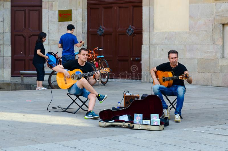 Street musicians play guitars in Gothic quarter of Barcelona, Spain stock image