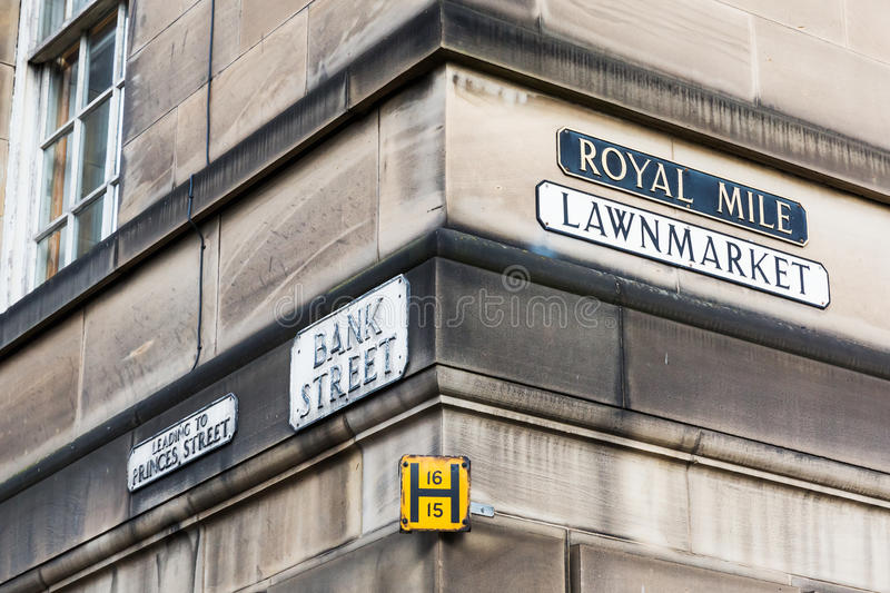 Street name signs at a house wall in Edinburgh. Scotland, UK royalty free stock images