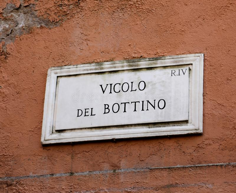 Street name VICOLO DEL BOTTINO which means Booty alley in Italia. N language in Rome in Italy stock photography
