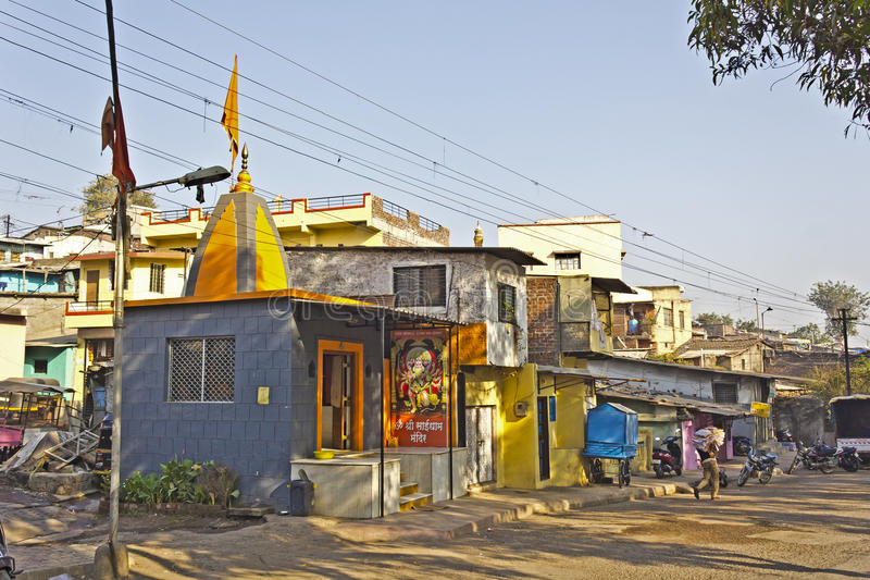 Street in Nashik. FEB 6, 2015, NASHIK, INDIA - Small street in Nashik with a little Hindu temple royalty free stock photography