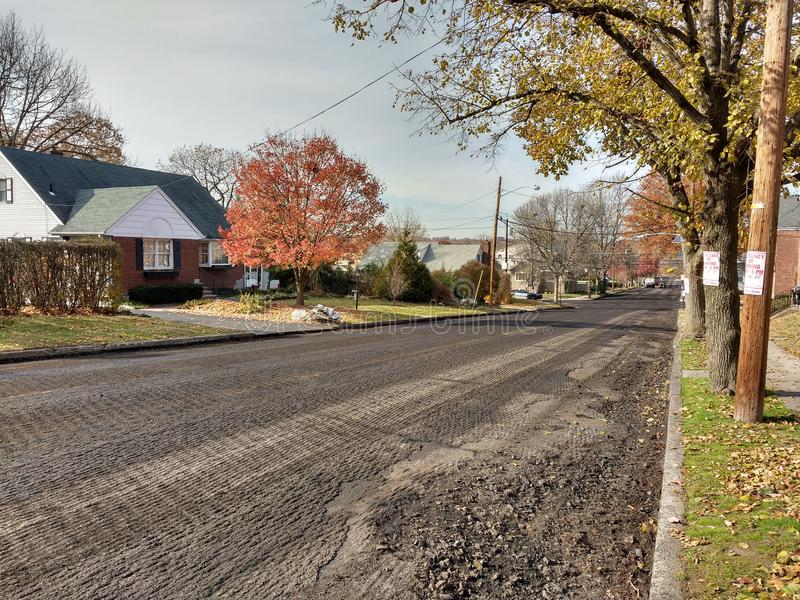 Resurfacing the Street, Roadwork in a Residential Neighborhood, USA royalty free stock images