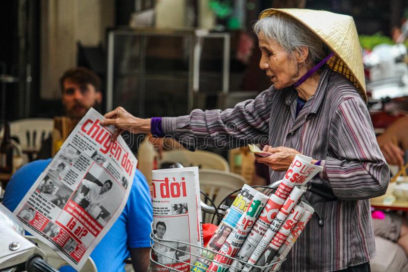 Street newspaper seller Hanoi royalty free stock image