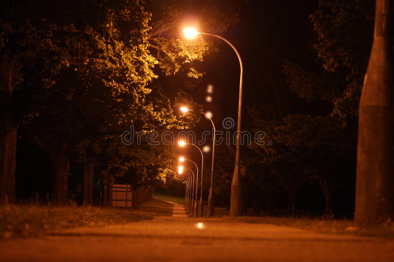 Street night. Footpath at night, street lamps dark outdoors life art royalty free stock image