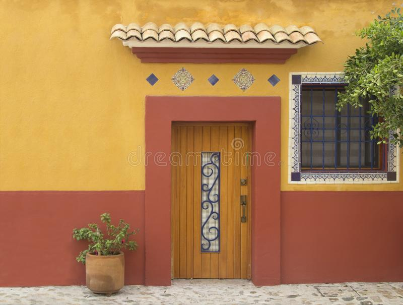 A typical facade from the city of Oaxaca. In a street of Oaxaca City a beautiful facade on warm colors royalty free stock photo