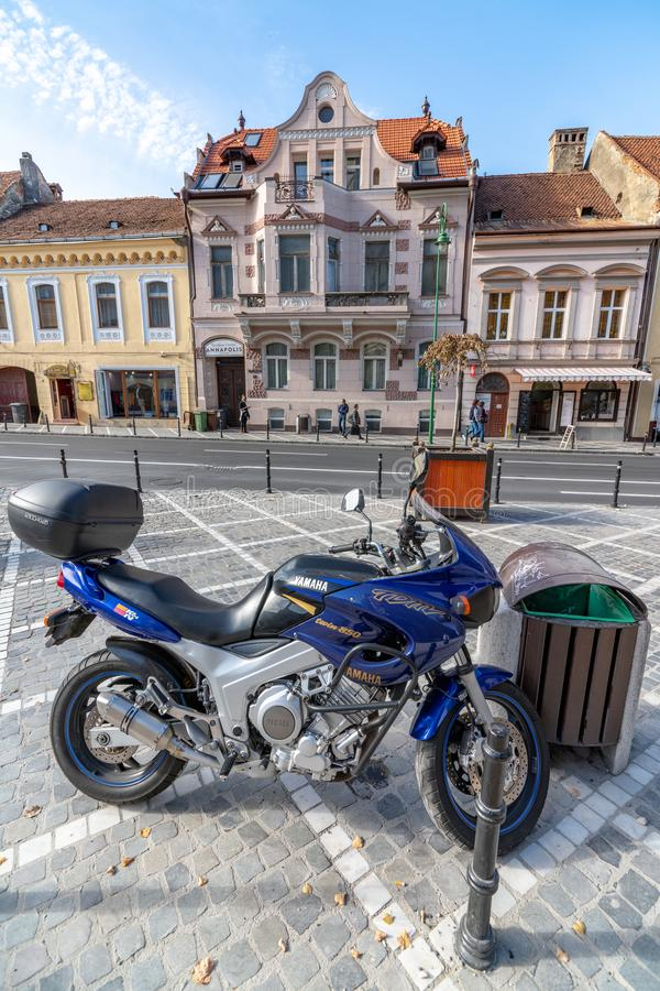 On the street of old Brasov in Romania. One of the ten largest cities in Romania. Located in the heart of Romania, the city of Brasov is sometimes called the stock photography