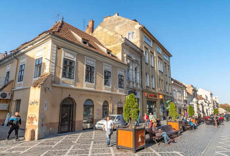 In the street of old Brasov, Romania. One of the ten largest cities in Romania. Located in the heart of Romania, the city of Brasov is sometimes called the royalty free stock images