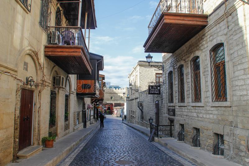 Street of the old city of the capital of Baku with stone houses and narrow streets royalty free stock photos