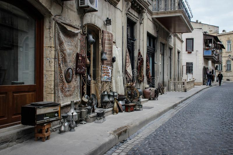 Street of the old city of the capital of Baku with stone houses and narrow streets stock photography