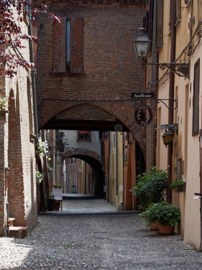 Street in old city of Ferrara, Italy. Ferrara, Italy - June 17, 2017: Via delle Volte street in the old city. Historical part of the city is listed as UNESCO royalty free stock photo