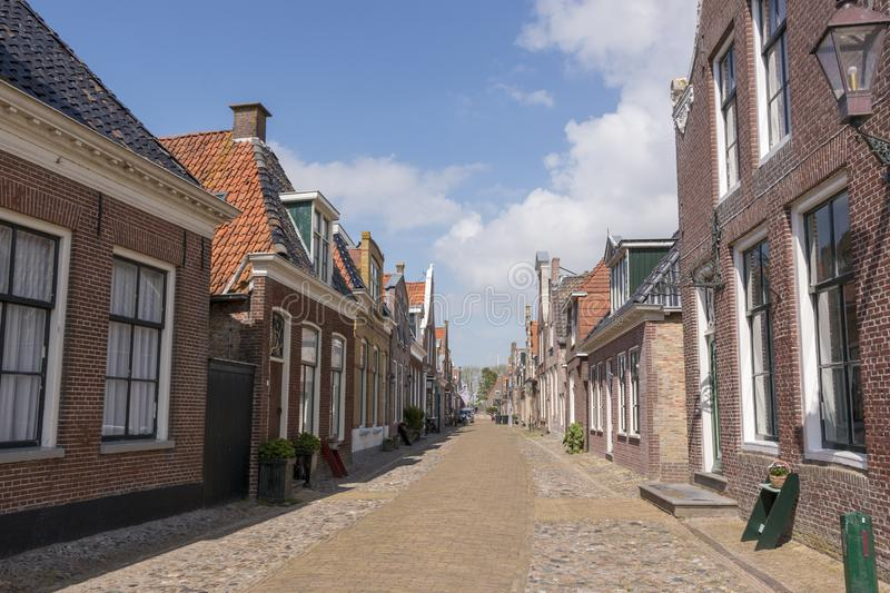 Street with old houses in a a historical city in the lake side district of the Netherlands. Hindeloopen, one of the eleven cities in the province of Friesland in royalty free stock photo