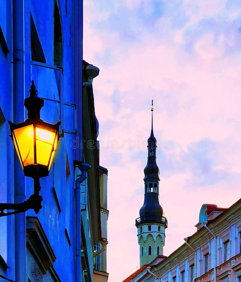 Street old lamp light on building medieval Tallinn old town city for travel  lifestyle. Wet asphalt city night raindrops water reflection autumn leaves  fall stock images
