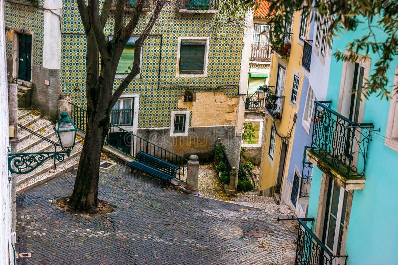 Street in the old neighborhood of Alfama, Lisbon royalty free stock photo