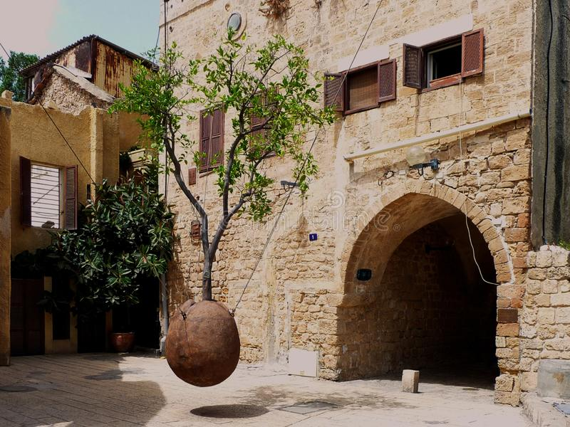 Street in the old quarter of Jaffa. Tel Aviv. Israel. Decoration in the street with hanging tree. Historic quarter of Tel Aviv Jaffa. Israel royalty free stock image