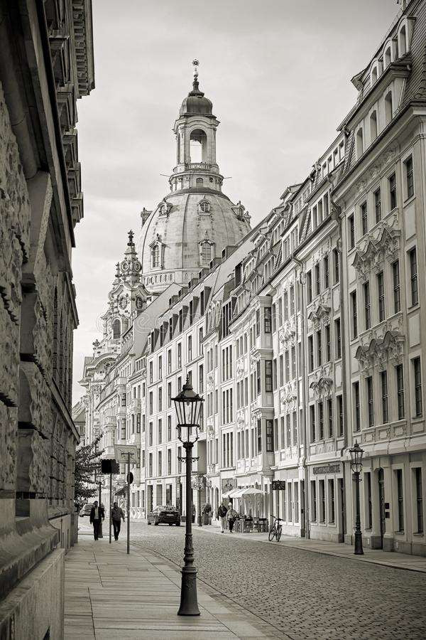 Street in the old town of Dresden and the rebuilt Frauenkirche royalty free stock photography