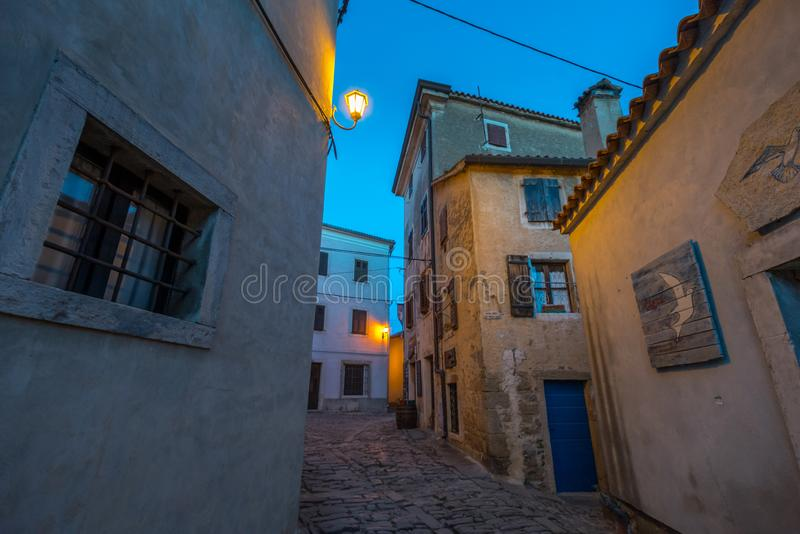 Groznjan Street at afternoon. Street of Old Town Groznjan, Istria, Croatia, photographed with my Nikon D750 at Winter afternoon and blue Hour royalty free stock photography