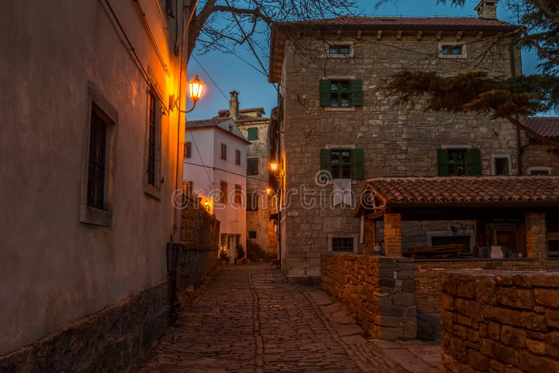 Groznjan Street at late afternoon. Street of Old Town Groznjan, Istria, Croatia, photographed with my Nikon D750 at Winter afternoon and blue Hour royalty free stock photos