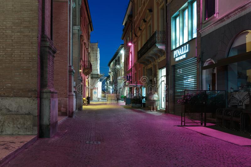 Street in the old town at night in Italy. RIMINI, ITALY - JUNE 27, 2014: Street in the old town at night royalty free stock image